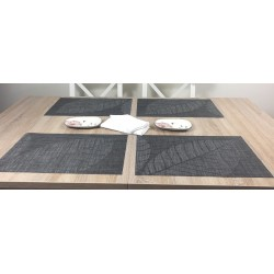 All four tablemats with centre piece. Woven vinyl Fleximats Sable design by Plymouth Pottery