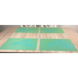 Dining table setting of vibrant green Verdigris woven vinyl tablemats