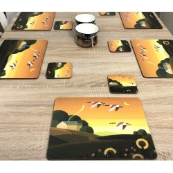 Dining table display with bowls of Plymouth placemats corkbacked Summer Gold design