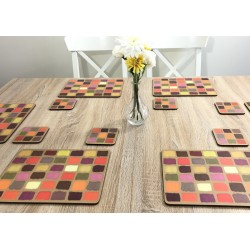 Wooden dining table. Corkbacked funky placemats colourful Harlequin pattern.