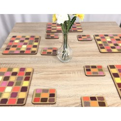Wooden table setting. Corkbacked funky placemats colourful Harlequin pattern.