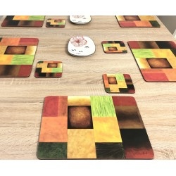 Majestic design of vibrantly coloured corkbacked placemats on wooden dining table