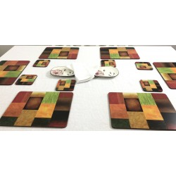 Majestic design of vibrantly coloured corkbacked placemats on dining table with white tablecloth