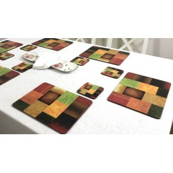 Majestic design of Plymouth Pottery corkbacked placemats on dining table with white tablecloth