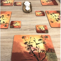Stylish set of Sunset design drinks coasters. Square with soft cork backing. Shown against wooden dining table