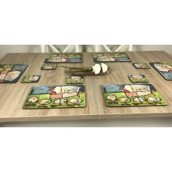 Wooden table with Plymouth Mother Hen drinks coasters