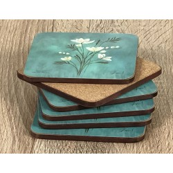Infinity corkbacked floral coasters fanned out with base displayed