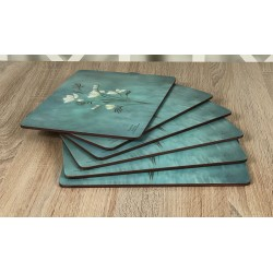 Infinity, teal blue background, corkbacked floral placemats fanned out all six mats