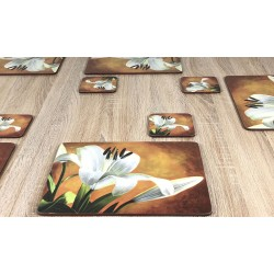 Lily Sunburst design cork backed floral coasters on wooden table