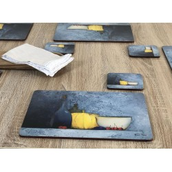 Blue Harmony fruit based set of 6 tablemats on wooden table with white napkin